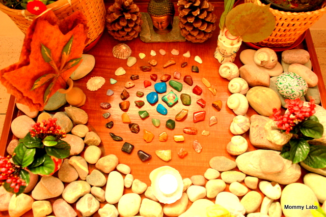 art with river stones nature table