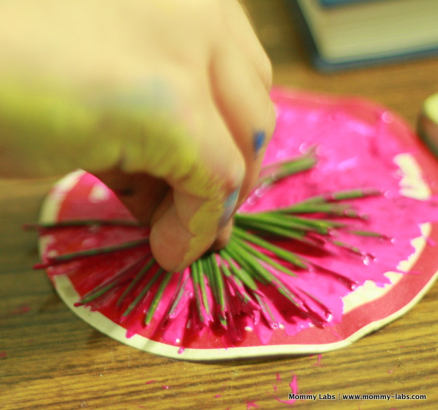 kids art printing with pine leaves