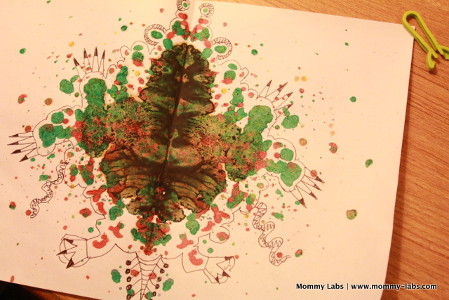 ink blot type art with melted crayon